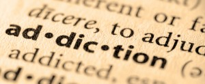 closeup - addiction in dictionary