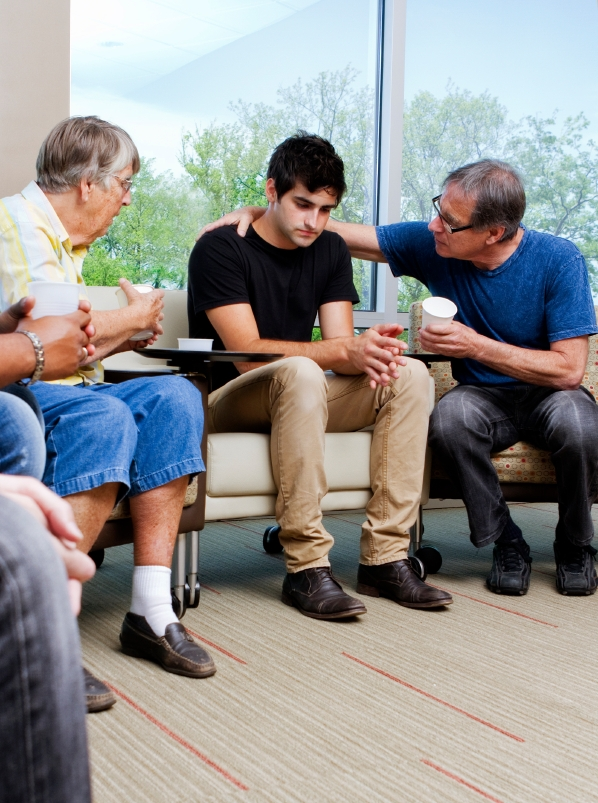 contracts - support group young man with older men