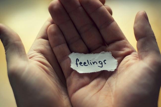 feelings8 - hands holding scrap of paper