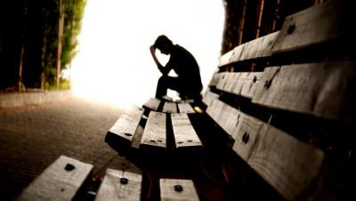 self-destructive - man on wooden bench