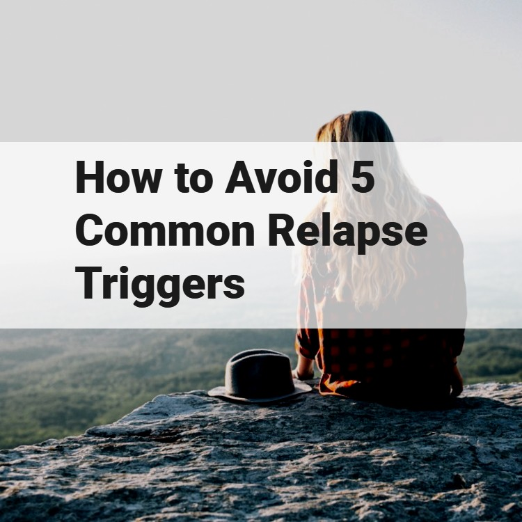 woman sitting on cliff - how to avoid relapse triggers