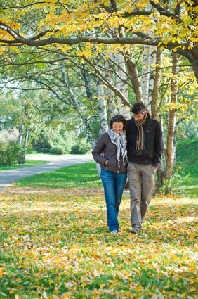 couple walking through St. Joseph Institute's beautiful property