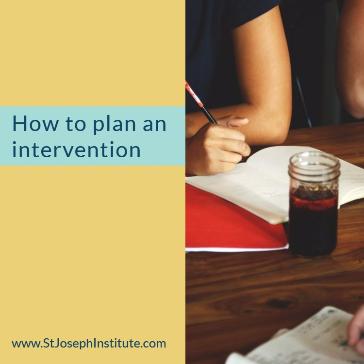 someone making notes at a desk or table - How to plan an intervention