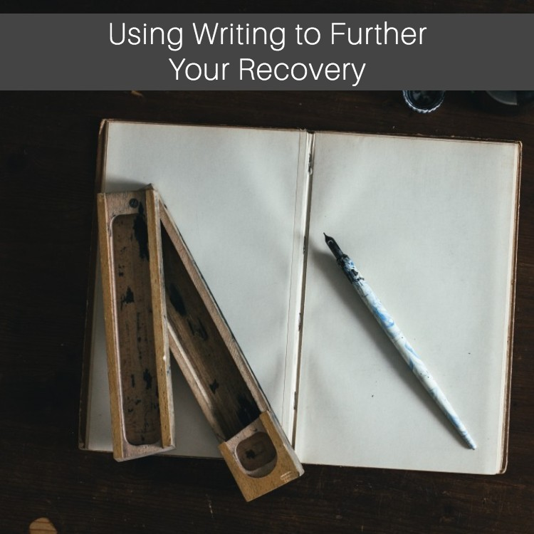 open journal with pen - Using Writing to Further Your Recovery