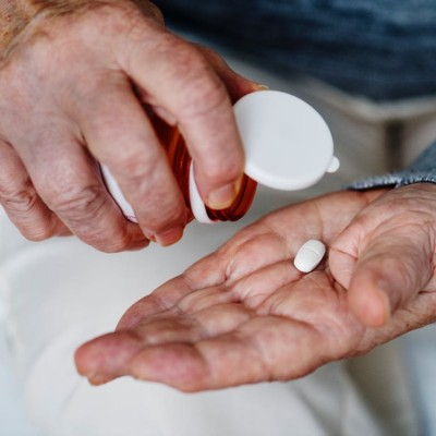 person taking pills