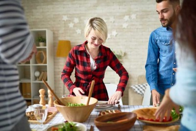 Enjoying-Your-First-Sober-Holiday-Season - friends setting holiday table for meal