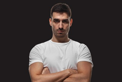 Masculinity, Trauma, and Addiction: Breaking the Cycle of Toxic Masculinity to Get Men the Help They Need - man with arms crossed