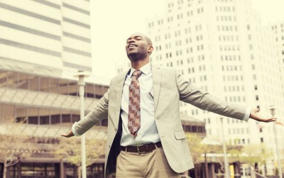 african american business man enjoying deep breath outside
