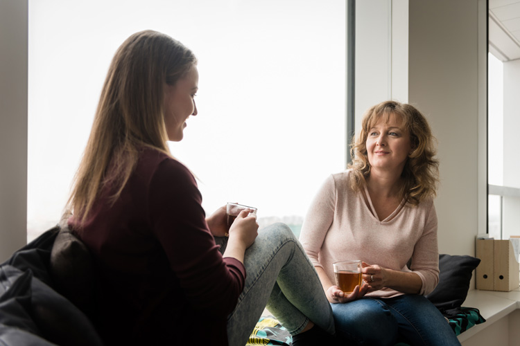mother having conversation with daughter