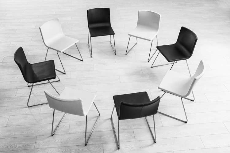 group of empty chairs in circle - celebrate recovery