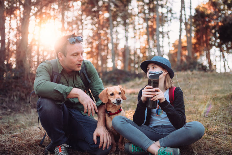 man on hike with teenage daughter and dog - talking - teens