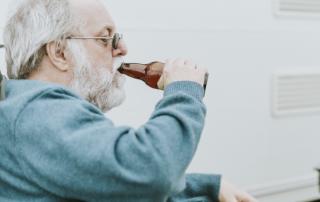 older man with bottle - drinking